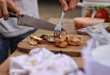 esting food with knife and folk