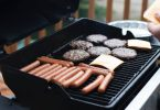 hot dogs and meat grilling on bbq grill